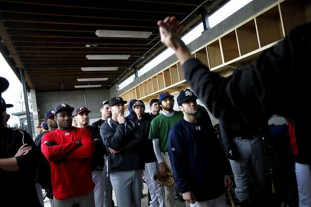 Baseball hopefuls listen to instructions before taking to the field during tryouts for the San Rafael Pacifics in Oakland, Calif., Sunday, January 22, 2012.  The Pacifics are a new independent team in the North American Baseball League. Photo: Sarah Rice, Special To The Chronicle