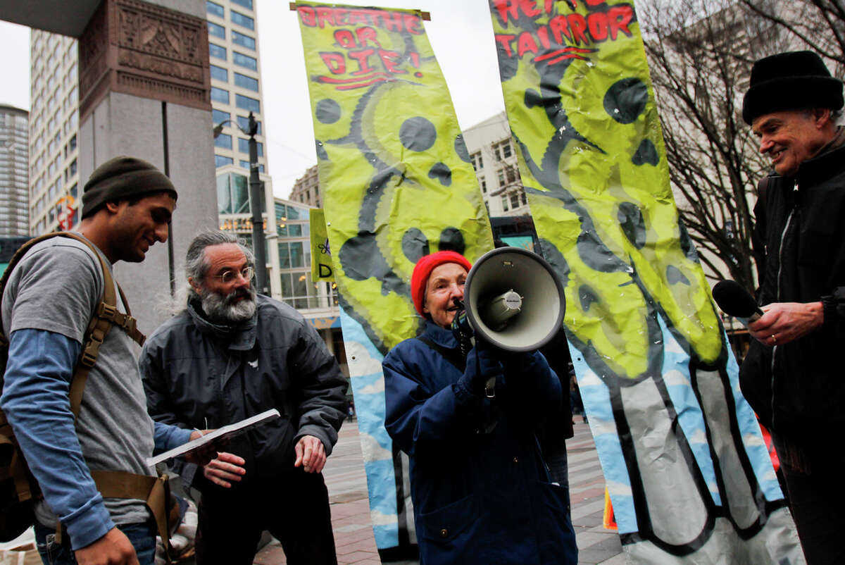 Protestors led by Occupy Seattle's Dorli Rainey demand an end to what they say is pollution created by the Seattle Steam incinerator located near Pike Place Market on Saturday, Feb. 11, 2012. The group claims that the Seattle Steam incinerator releases large amounts of deadly chemicals into the air harming residents in nearby low income housing areas.