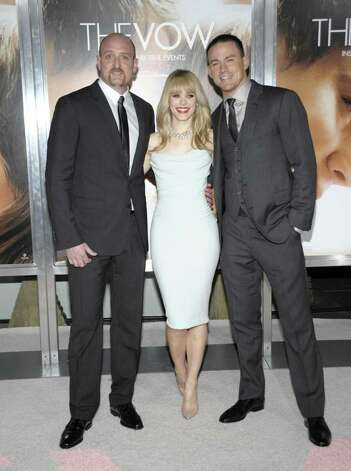 "Director Michael Sucsy, from left, actress Rachel McAdams, and actor Channing Tatum arrive at the premiere of the feature film ""The Vow"" in Los Angeles on Monday, Feb. 6, 2012. (AP Photo/Dan Steinberg) Photo: Dan Steinberg"
