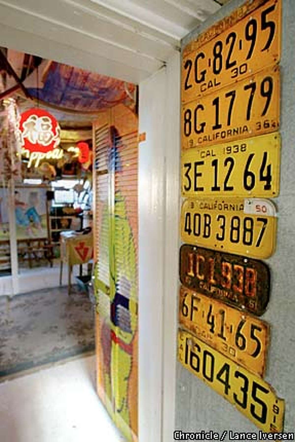 Front Door: A collection of old California license plates greets the visitor to Fontes' studio. Chronicle photo by Lance Iversen