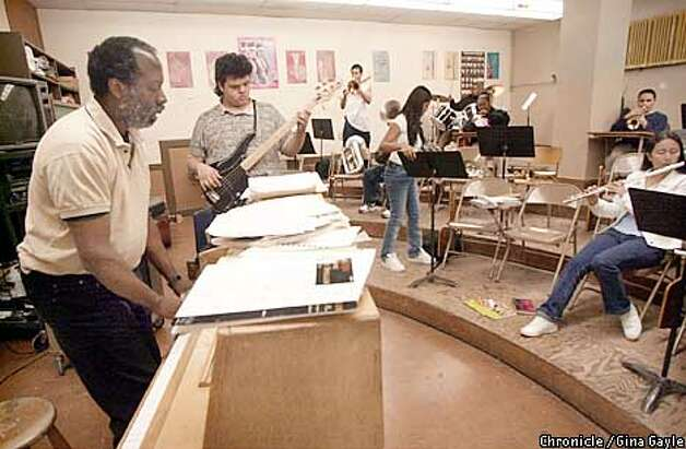 Music teacher Art Davis (l) rehearses with the Mission High Band in preparation for an upcoming competition at the Music in the Parks festival in Los Angeles. Photo by Gina Gayle/The SF Chronicle. Photo: GINA GAYLE