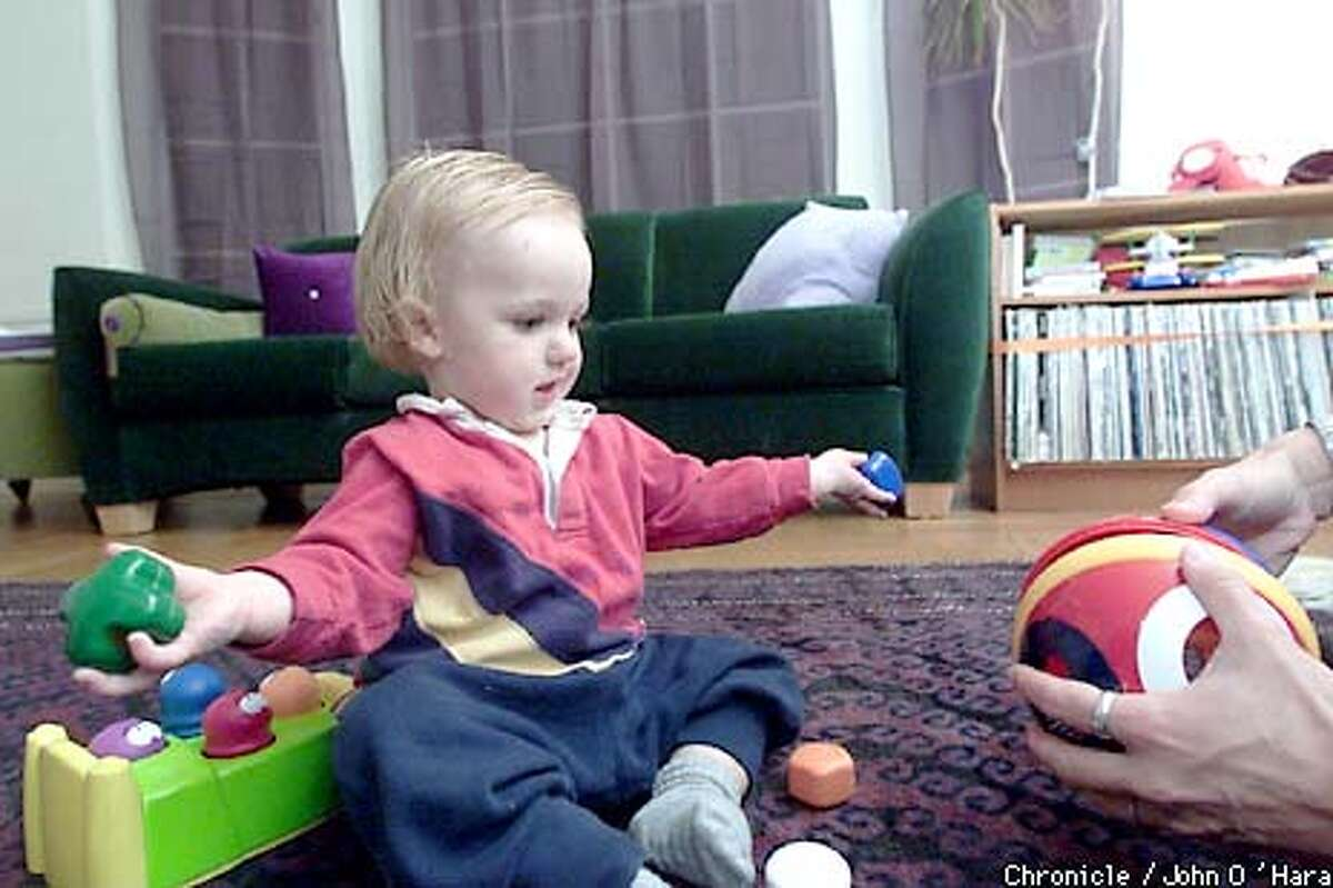 """San Francisco,CA """"Harry"""" , playing a game with safe toys, that are to big to swallow, and theat require thought to play Photo/John O'Hara"""