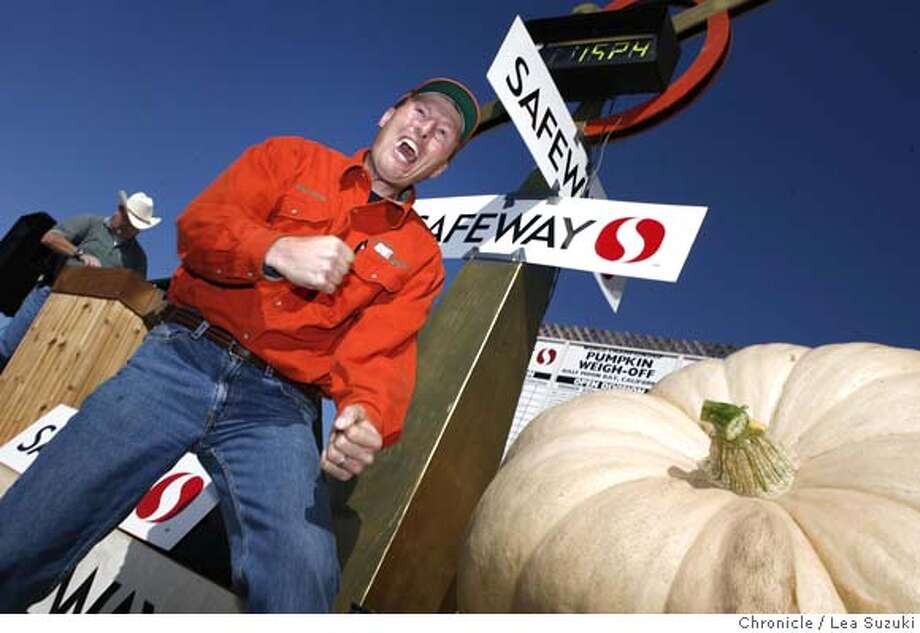 """PUMPKIN_210_ls.jpg  Thad Starr of Pleasant Hill, OR. reacts after the weight of his pumpkin is announced at the Safeway World Championship Pumpkin Weigh-Off in Half Moon Bay. It weighs 1524 lbs has a height of 4' 3"""" and a circumference of 14' 4"""". Safeway World Championship Pumpkin Weigh-Off in Half Moon Bay on Monday October 8,2007. Lea Suzuki / The Chronicle Photo taken on 10/8/07, in San Francisco, CA, USA Photo: Lea Suzuki"""