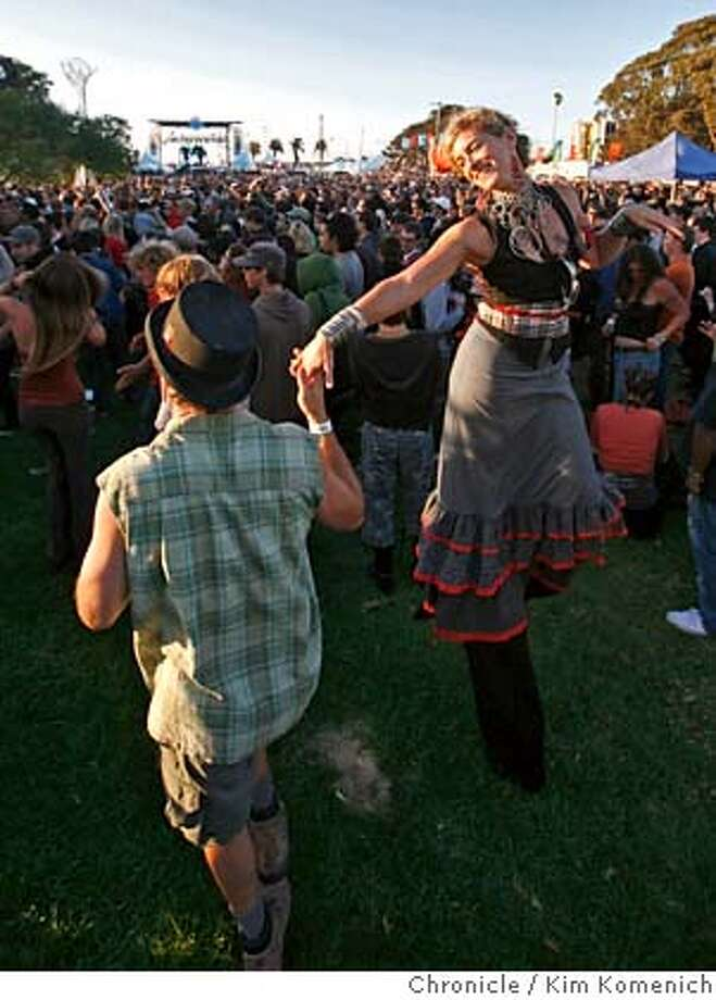 TREASUREISLAND_083_KK.JPG  Hilary Nichols (right, on stilts) dances with Michael Christian at the Treasure Island Music Festival on Treasure Island Saturday.  Photo by Kim Komenich/The Chronicle  **Hilary Nichols, Michael Christian Photo: Kim Komenich