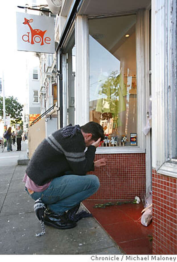 Peter Helmenstine of San Francisco left three white carnations at the doorway of Doe, a store out in the Haight owned by the Kims. Helmenstine who was a friend of a friend of the family paused and wept in front of the closed store.  Local (San Francisco) reaction to news that rescuers today found the body of James Kim, the San Francisco dad who left his stranded family to find help in the snowy Oregon wilderness.  Photo by Michael Maloney / San Francisco Chronicle Photo: Michael Maloney