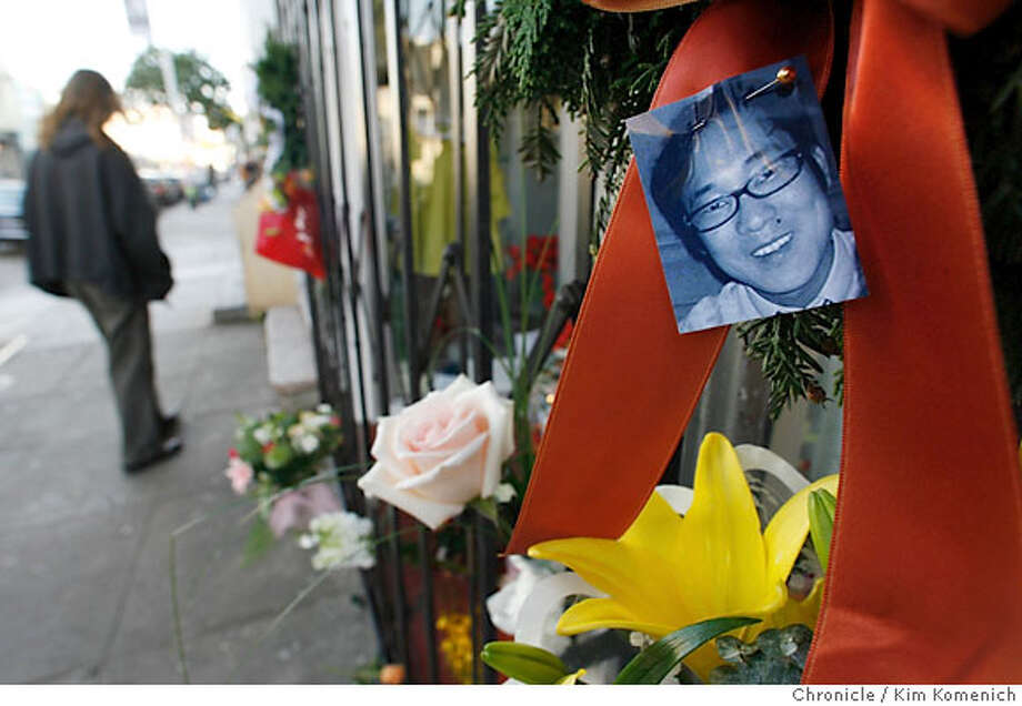 "FAMILY08_063_KK.JPG  Friends, customers and acquaintances left sympathy flowers, cards and candles at the door of ""Doe"" , at 629 Haight St., one of the businesses owned by James and Kati Kim. James Kim died of hypothermia in Oregon last week while trying to find help for his stranded family . Photo Ran on: 12-08-2006  Flowers for James Kim adorn the family's Doe store in San Francisco's Haight.  Ran on: 12-08-2006 Photo: Kim Komenich"