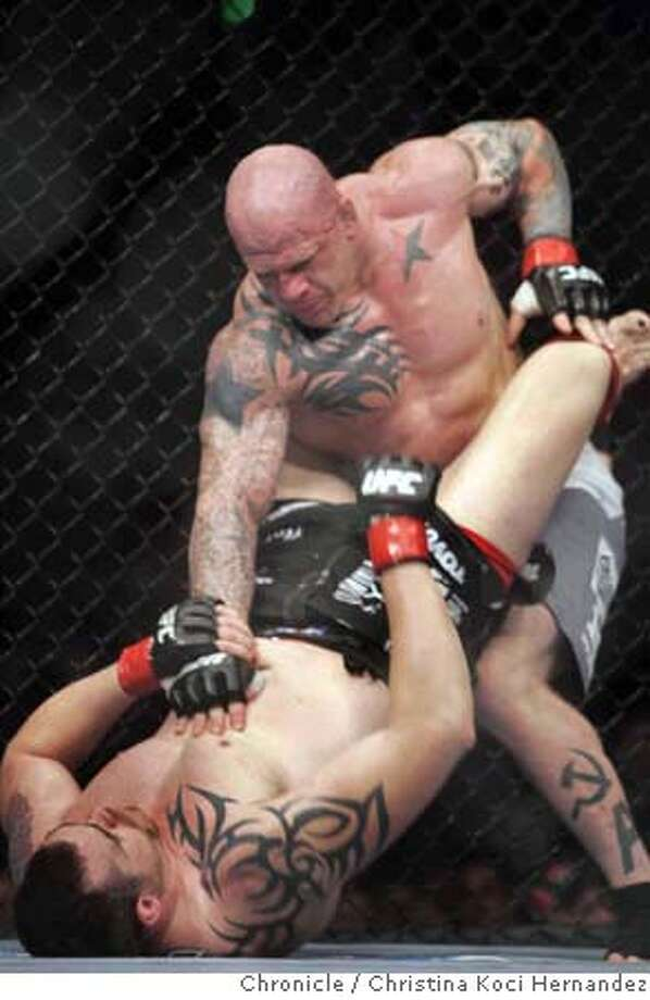 "(TOP) Jeff ""The Snowman"" Monson holds down Tim Sylvia. Feature on Ultimate Fighting, a martial arts/boxing combat sport that is getting very popular very fast. Looking for good shots of the fighting itself, as well as atmosphere -- fans, merchandise, etc.The big fights Saturday at ARCO are UFC World Welterweight Champion Matt Hughes vs. Georges �Rush� St. Pierre, No 1 Welterweight Contender and UFC World Heavyweight Champion Tim �The Maine-iac� Sylvia vs. �The Snowman� Jeff Monson, No. 1 Heavyweight Contender. (CHRISTINA KOCI HERNANEZ/CHRONICLE) CHRONICLE Photos by CHRISTINA KOCI HERNANDEZ Photo: CHRISTINA KOCI HERNANEZ/CHRONICL"