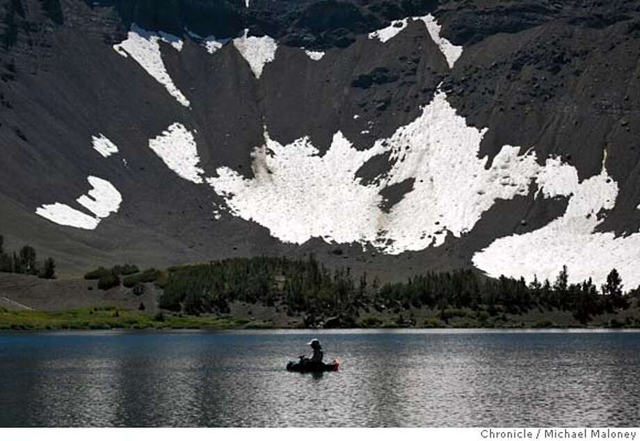A lone flyfisherman in a float tube is dwarfed by the huge walls surrounding Leavitt Lake (elevation : 9,400 feet) just south of Sonora Pass in the Sierras. Photo by Michael Maloney / San Francisco Chronicle on 8/26/06 in Sonora Pass,CA MANDATORY CREDIT FOR PHOTOG AND SF CHRONICLE/ -MAGS OUT Photo: Michael Maloney