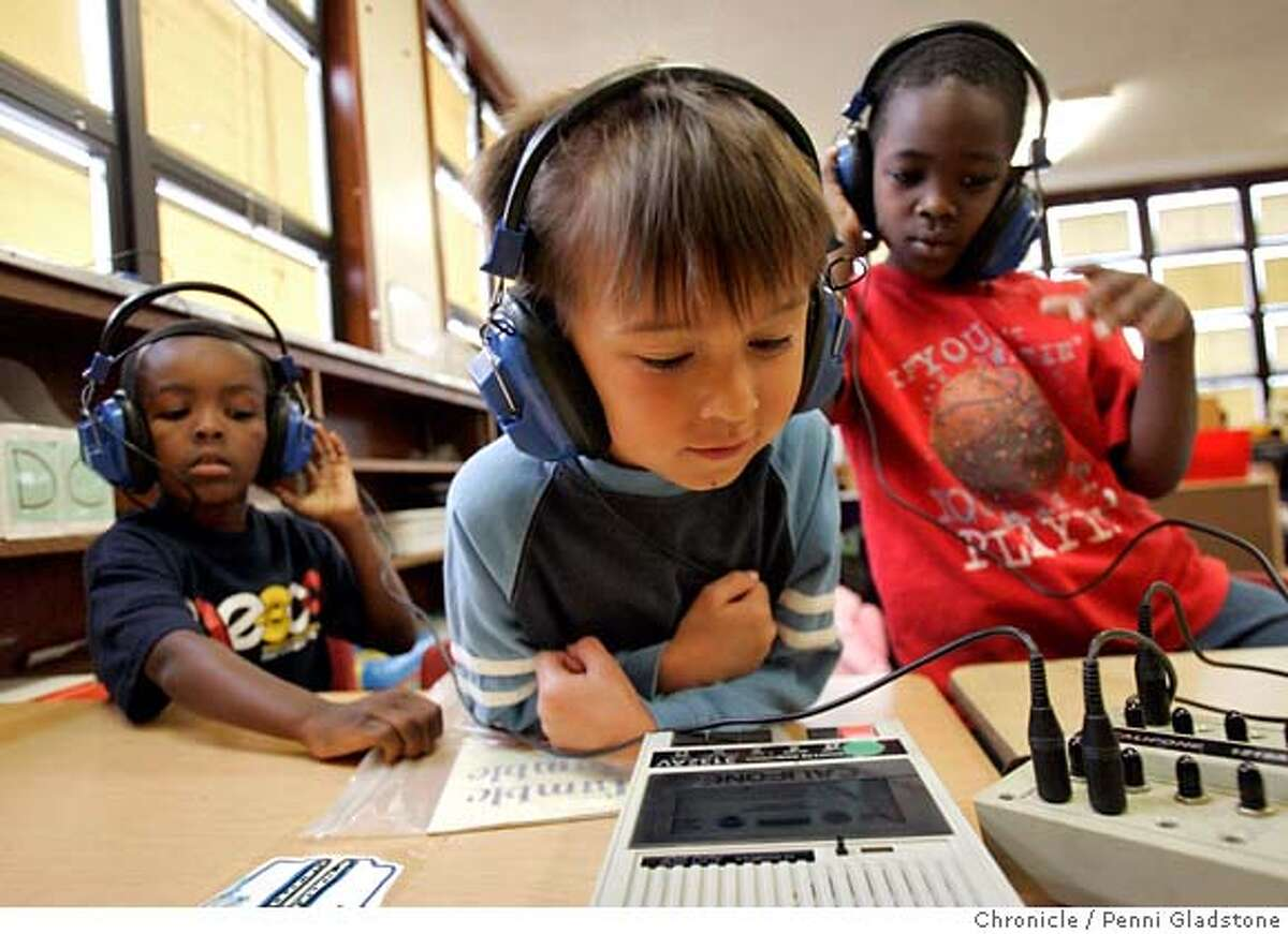 Antonio Johnson, Cha' Yim Reed, and Jet Tan with headphones on at the listening center in their classroom at Starr King Elementry School Kindergarten preparation class. Event on 8/15/06 in San Francisco. Penni Gladstone / The Chronicle ***cq the kids and teacher's list MANDATORY CREDIT FOR PHOTOG AND SF CHRONICLE/ -MAGS OUT