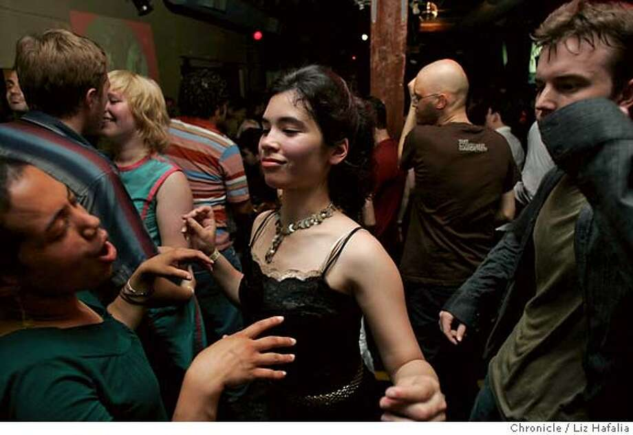 .JPG Left to right--Danielle Wright from San Mateo, Rosana Sullivan, a University of San Francisco student, and David Mistysyn dancing at Popscene - one of the longest running clubs in the city - celebrating its 10th anniversary. Danielle Wright, Rosana Sullivan, David Mistysyn (cq). Liz Hafalia/The Chronicle. MANDATORY CREDIT FOR PHOTOGRAPHER AND SAN FRANCISCO CHRONICLE/ -MAGS OUT Photo: Liz Hafalia