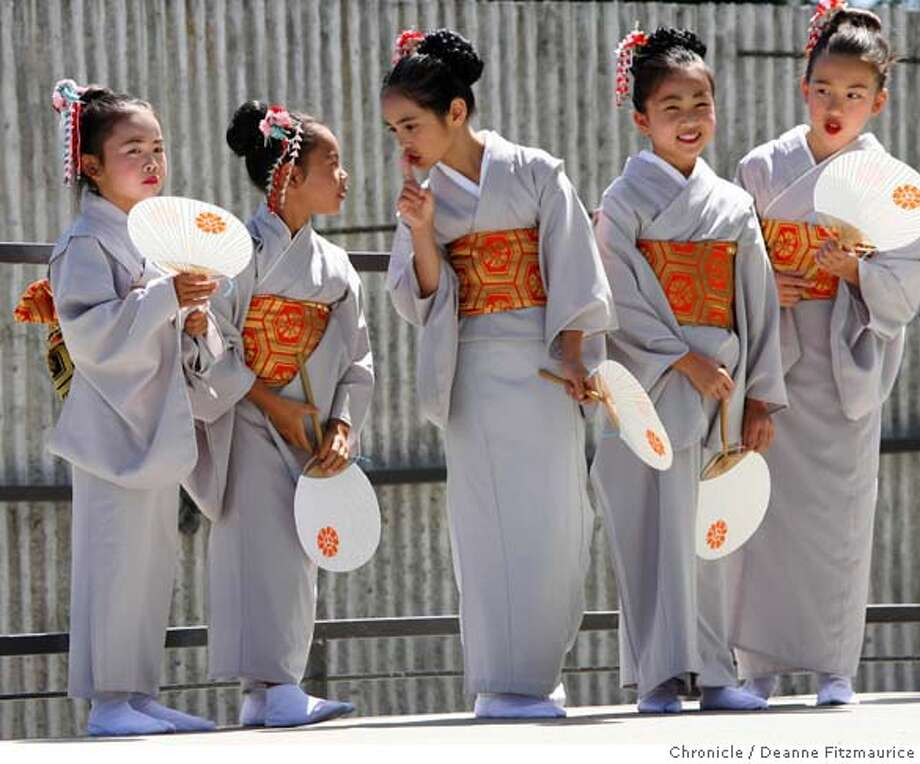 japantownfest_0311_df.jpg  A older dancer tells one of the younger dancers to be quiet as they wait in the wings of the stage for their turn to dance. The Michiya Hanayagi Classical Japanese Dance group wait to perform for the crowd. The Japantown Festival was held in Japantown's Peace Plaza. Photographed in San Francisco on 8/26/06.  (Deanne Fitzmaurice/ The Chronicle) Mandatory credit for photographer and San Francisco Chronicle. /Magazines out. Photo: Deanne Fitzmaurice