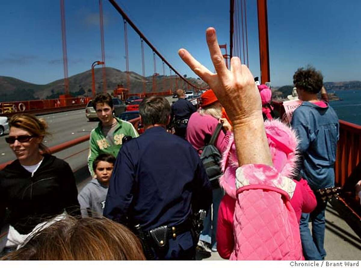 codepink_307.JPG CodePink marchers flashed the peace sign to other Golden Gate Bridge walkers and motorists as they walked. Members of the CodePink group marched across the Golden Gate Bridge Sunday afternoon in preparation for their upcoming hunger strike outside the homes of Sen. Dianne Feinstein and House Speaker Nancy Pelosi. Over 100 activists got the attention of motorists on the bridge, many of whom honked their approval. {By Brant Ward/San Francisco Chronicle}8/12/07