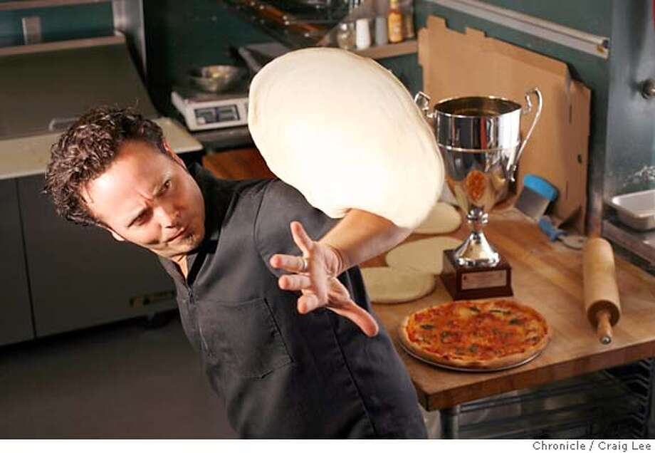 PIZZA15_072_cl.JPG  An American pizza maker from Castro Valley went to Italy to beat the Italians at what they do best: making pizzza. Tony Gemignani of Pyzano's in Castro Valley won the prestigious Naples Trophy for making pizza according to the exacting standards of real Neapolitan pizzaiolo. Photo of Tony Gemignani rolling some pizza dough across his arm.  Event on 8/10/07 in Castro Valley. photo by Craig Lee / The Chronicle MANDATORY CREDIT FOR PHOTOG AND SF CHRONICLE/NO SALES-MAGS OUT Photo: Photo By Craig Lee