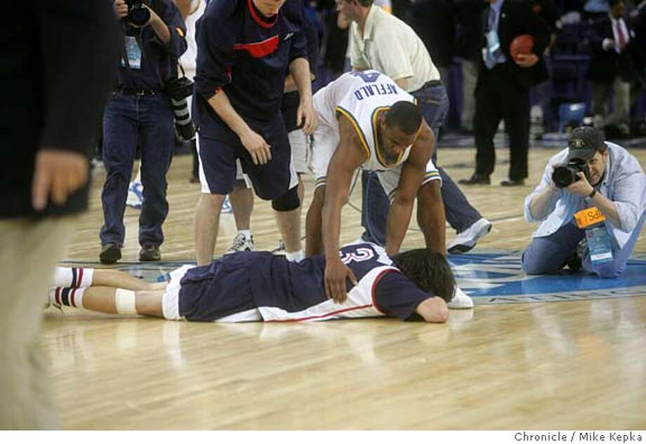 Gonzaga's #3 Adam Morrison falls to the ground after UCLA wins in the last seconds of the game. UCLA beats Gonzaga in final second of a brutal game. Gonzaga Bulldogs and UCLA Bruins  The Oakland Arena hosts two NCAA Division 1 Men's Basketball games Thursday. Mike Kepka / The Chronicle Photo: Mike Kepka