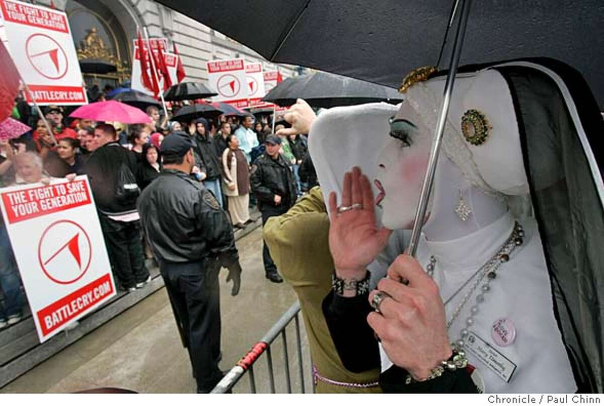Sister Mary Timothy, of the Sisters of Perpetual Indulgence, shouts at Christian youths holding a rally on the steps of City Hall in San Francisco, Calif. on 3/24/06. The young Christians are gathering for two days of rallies at AT&T Park against pop culture forces contributing to teen sex, drug abuse, and teen suicide among other things. PAUL CHINN/The Chronicle MANDATORY CREDIT FOR PHOTOG AND S.F. CHRONICLE/ - MAGS OUT