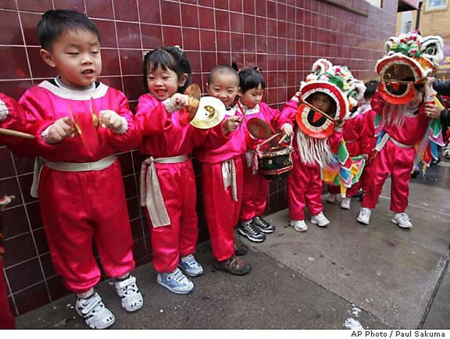 Chinese children of ages 4 and 5, from Lok Yuen Children's Center, perform a lion dance during a Chinese New Year celebration of the completion of the Waverly Place improvement project in San Francisco's Chinatown, Wednesday, Feb. 1, 2006. Waverly Place was built after the 1906 earthquake about 100 years ago. (AP Photo/Paul Sakuma) STAND ALONE PHOTO Photo: PAUL SAKUMA