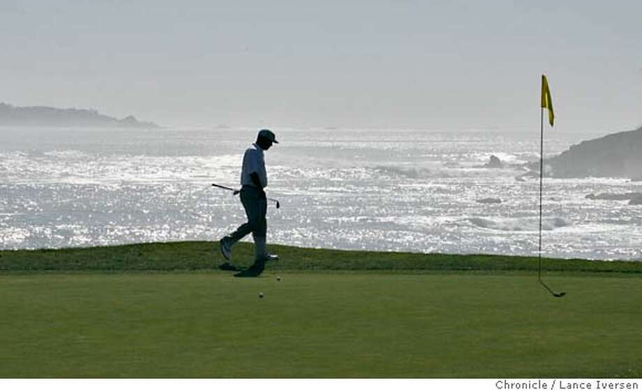 AT&T_0126.jpg_  Brian Bateman walks up onto the 18th green at Pebble Beach. Bateman along with amateurs and professional golfers alike took part in Tuesday's practice round of the 2006 AT&T Pebble Beach National Pro-Am. Play begins Thursday. By Lance Iversen/San Francisco Chronicle MANDATORY CREDIT PHOTOG AND SAN FRANCISCO CHRONICLE. Photo: Lance Iversen
