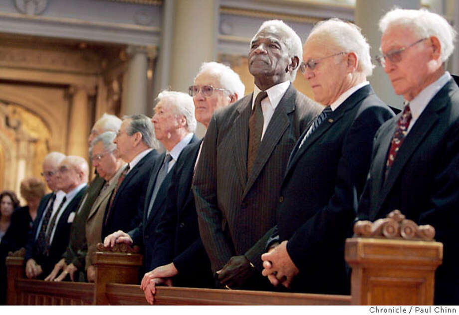 Burl Toler (third from right) stands with nine of his teammates during the USF commencement ceremony at St. Ignatius Church in San Francisco, Calif. on Friday, May 19, 2006. Players from the 1951 football team were bestowed with an honorary degree of Doctor of Humane letters for its stand against racism. Despite an undefeated record, the team was denied a post-season bowl berth because two of its players were black. When the Orange Bowl finally expressed interest - only if the two were excluded - the team refused the bid.  (L to R: Joseph Arenivar, Jim Whitney, Hal Sachs, Bob Springer, Dick Huxley, Bill Henneberry, Ralph Thomas, Burl Toler, Dick Colombini, Vincent Sakowski.)  PAUL CHINN/The Chronicle  **Joseph Arenivar, Jim Whitney, Hal Sachs, Bob Springer, Dick Huxley, Bill Henneberry, Ralph Thomas, Burl Toler, Dick Colombini, Vincent Sakowski Photo: PAUL CHINN
