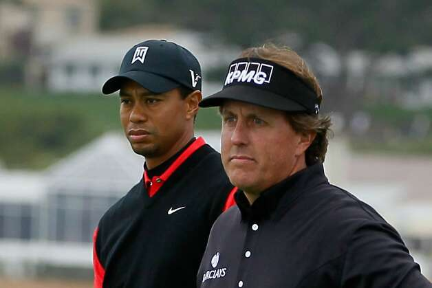 PEBBLE BEACH, CA - FEBRUARY 12: (L-R) Tiger Woods and Phil Mickelson wait on the seventh hole tee during the final round of the AT&T Pebble Beach National Pro-Am at Pebble Beach Golf Links on February 12, 2012 in Pebble Beach, California.  (Photo by Jeff Gross/Getty Images) Photo: Jeff Gross, Getty Images