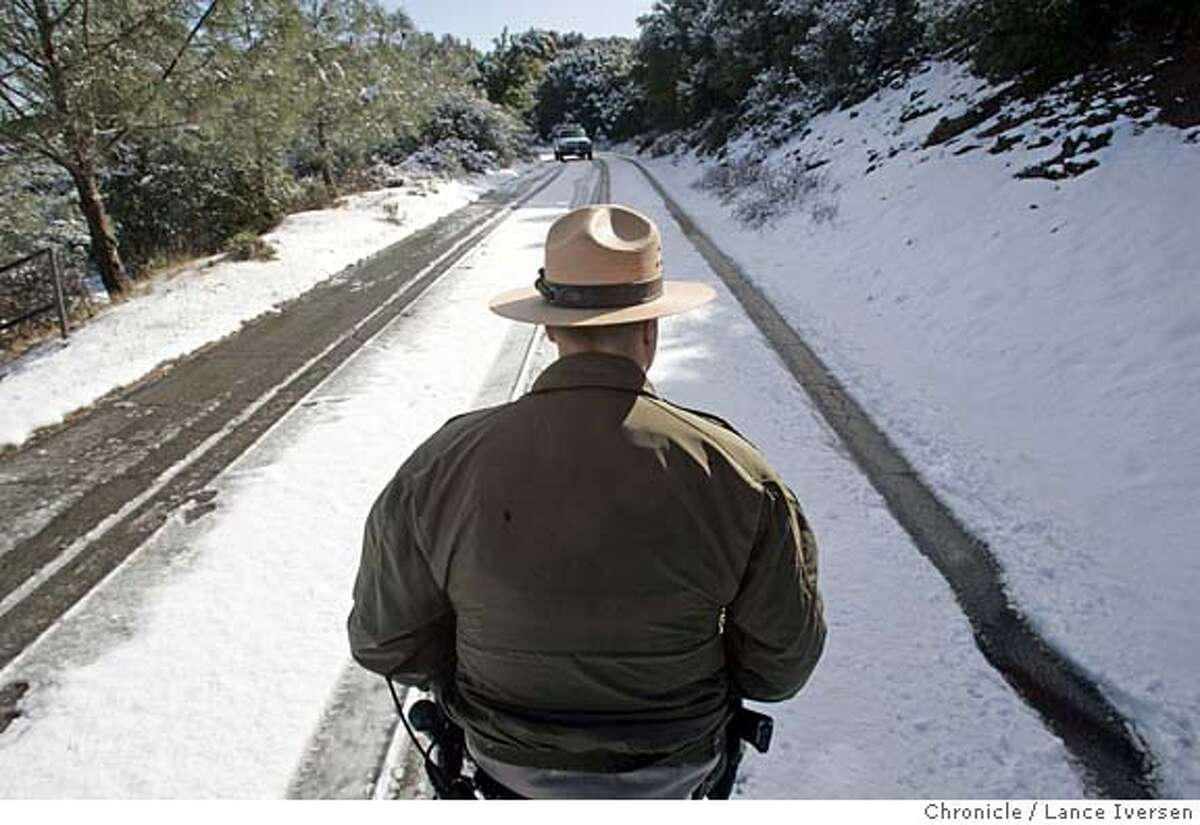 WEATHER_LI_0060.jpg_ California State Park Ranger Jeremy Olson walked up to the Mt Diablo summit checking the road prior to opening it up to the public. Numerous showers and scattered thunderstorms dumped over three inches of snow atop Mt Diablo in Walnut Creek Wed night. By Lance Iversen/San Francisco Chronicle MANDATORY CREDIT PHOTOG AND SAN FRANCISCO CHRONICLE.