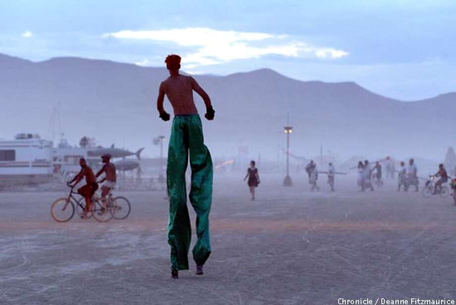 A man on stilts walks across the playa at Burning Man in the Black Rock Desert in Nevada.  CHRONICLE PHOTO BY DEANNE FITZMAURICE Photo: DEANNE FITZMAURICE