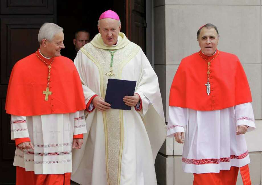 Cardinal Donald Wuerl, left, of Washington, Rev. Jeffrey N. Steenson, center, and Cardinal Daniel DiNardo,  right, walk outside the Co-Cathedral of the Sacred Heart, 1111 St. Joseph Parkway, Sunday, Feb. 12, 2012, in Houston to speak with the media before the Mass of Institution for the Ordinariate of the Chair of Saint Peter. During the mass the Reverend Jeffrey Steenson was installed as the first Ordinary, or head, of the Ordinariate of the Chair of Saint Peter and given the title of Monsignor. Photo: Melissa Phillip, Houston Chronicle / © 2011 Houston Chronicle