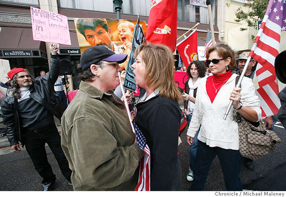 Deborah Johns of Granite Bay, CA (right) has a heated face to face discussion with Asher Wolf of Richmond, CA who is a supporter of CodePink. Johns has a son, Marine Corps Sgt William Johns currently serving in Iraq.  Pro-military demonstrators faced off in downtown Berkeley, CA against CodePink, saying the anti-war group defaced a U.S. Marines recruiting center that opened in Berkeley last January. Photo taken on Shattuck Ave outside the Marine Corps recruiting station on October 17, 2007.  Photo by Michael Maloney / San Francisco Chronicle  ***Deborah Johns, Asher Wolf Photo: Michael Maloney