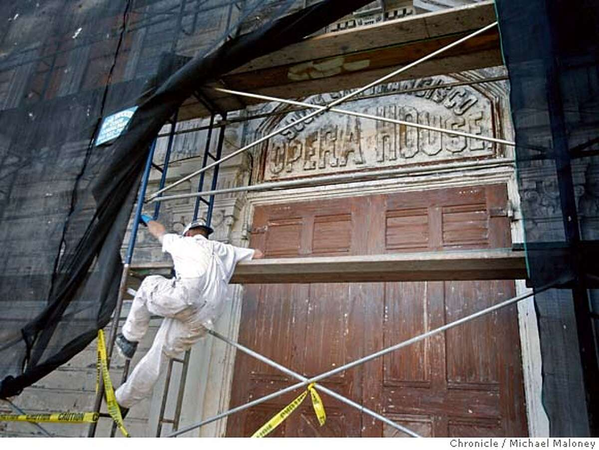 The front of the historic opera house built in 1888 is undergoing renovation as part of a city project (NOTE : this is not connected to the work SWA Group is doing). Jimmy Ford of the SF DPW climbs down from the scaffolding. On Friday Oct. 19, a ceremony will celebrate a public-private partnership creating a major facelift for one of San Francisco�s historic landmarks, the Bayview Opera House. Locally-based SWA Group, a landscape architecture firm is leading a pro-bono implementation in celebration of the firm�s 50th anniversary. The community celebration on Friday culminates a two-day transformation of the Bayview Opera House grounds on Third Street in San Francisco. Photo taken on 10/18/07. Photo by Michael Maloney / San Francisco Chronicle ***Jimmy Ford MANDATORY CREDIT FOR PHOTOG AND SF CHRONICLE/NO SALES-MAGS OUT