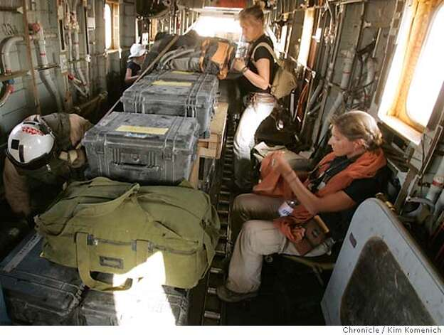 Anna Badkhen, right, front, and the CNN crew are among the passengers on the CH-58 helicopter on the flight from al Qaim to al Asad. Chronicle reporter Anna Badkhen blogs about her frustrations getting from our first embed with the Marines in al Qaim to our second embed with the Army in Tikrit. We somehow fell through the cracks and are scheming to get a helicopter flight in the direction of Tikrit. the blog deals with our frustration.  San Francisco Chronicle Photo by Kim Komenich  10/3/05 Photo: Kim Komenich