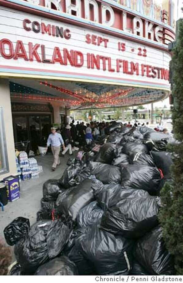 KATRIINA_GRANDLAKE_0046_PG.JPG GRAND LAKE THEATER owner organized a collection drive to help victims and refugees of Hurricane Katrina. tons of supplies in garbage bags wait for trucks to pick up goods. Many people sorted and collected  San Francisco Chronicle, Penni Gladstone  Photo taken on 9/8/05, in Oakland, Photo: Penni Gladstone