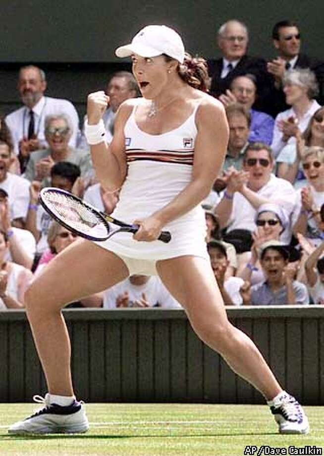 Jennifer Capriati punches the air as she takes a point from Serena Williams during their women's singles quarterfinal on the Centre Court at Wimbledon, Tuesday July 3, 2001. (AP Photo/Dave Caulkin) Photo: DAVE CAULKIN