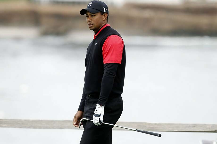 Tiger Woods stares down his shot on the par-3 7th hole, during the final round  of the 2012 AT&T Pebble Beach National Pro-Am Golf Tournament, in Pebble Beach, Ca. on Sunday Feb. 12, 2012. Photo: Michael Macor, SFC