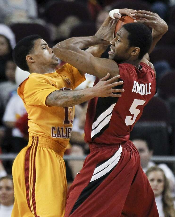 Stanford guard Chasson Randle, right, tries to keep the ball away from Southern California guard Maurice Jones during the second half of an NCAA college basketball game in Los Angeles, Sunday, Feb. 12, 2012. (AP Photo/Chris Carlson) Photo: Chris Carlson, Associated Press
