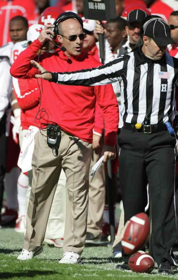 Named to succeed Kevin Sumlin as Houston's football coach Dec. 21, Tony Levine, left, hit the ground running and led the Cougars to a victory over Penn State in the Ticket City Bowl on Jan. 2. Photo: Nick De La Torre / © 2012  Houston Chronicle