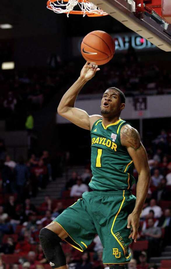 Baylor forward Perry Jones III dunks against Oklahoma in the first half of an NCAA college basketball game in Norman, Okla., Tuesday, Jan. 24, 2012. (AP Photo/Sue Ogrocki) Photo: Sue Ogrocki / AP
