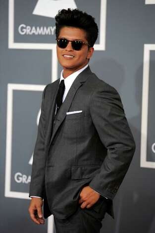 Bruno Mars sported his signature pompadour and Tom Brown suit - with no socks. Photo: Chris Pizzello, STF / AP