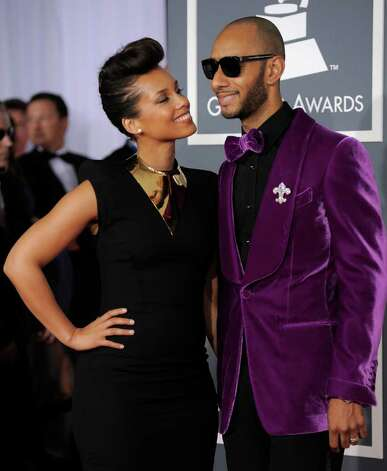 Alicia Keys channeled Janelle Monae in her pompadour, while husband Swizz Beats took a risk with his purple velvet jacket. Photo: Chris Pizzello, STF / AP