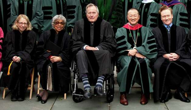 George H.W. Bush, with Dartmouth College President Jim Yong Kim, right, stood out last June among honorary degree recipients cartoonist Roz Chast, left, actress Ruby Dee and comedian Conan O'Brien, far right. Photo: Dartmouth  College / Dartmouth  College