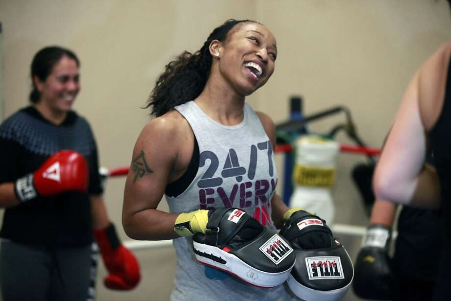 Raquel Miller is a San Francisco boxer, jokes with some of her students at the Mission Recreation Center gym. Miller is considered by most to be an elite boxer who will be trying out for the first U.S. Women's boxing team. She learned her sport, or art, in San Francisco's public gyms, and now she's teaching others Tuesday December 13, 2011. Photo: Lance Iversen, The Chronicle