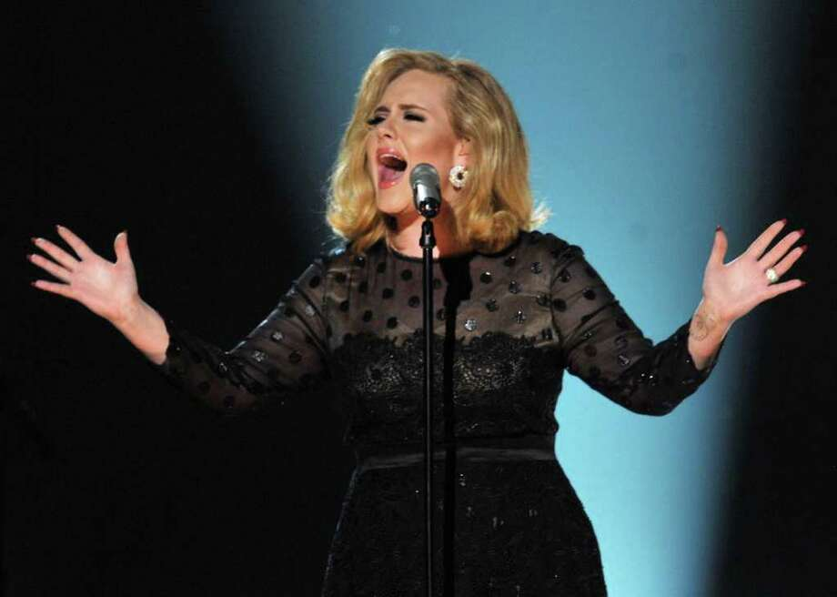 Adele's stellar performance at the 54th annual Grammy Awards on Sunday night was her first onstage since her recent throat surgery. Photo: Kevin Winter / 2012 Getty Images
