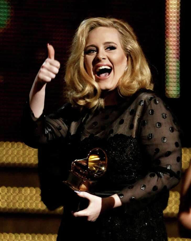 "Adele accepts the award for record of the year for ""Rolling in the Deep"" during the 54th annual Grammy Awards on Sunday, Feb. 12, 2012 in Los Angeles. (AP Photo/Matt Sayles) Photo: Matt Sayles, STF / AP"