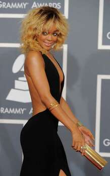 Rihanna arrives at the 54th annual Grammy Awards on Sunday, Feb. 12, 2012 in Los Angeles. (AP Photo/Chris Pizzello) Photo: Chris Pizzello, STF / AP