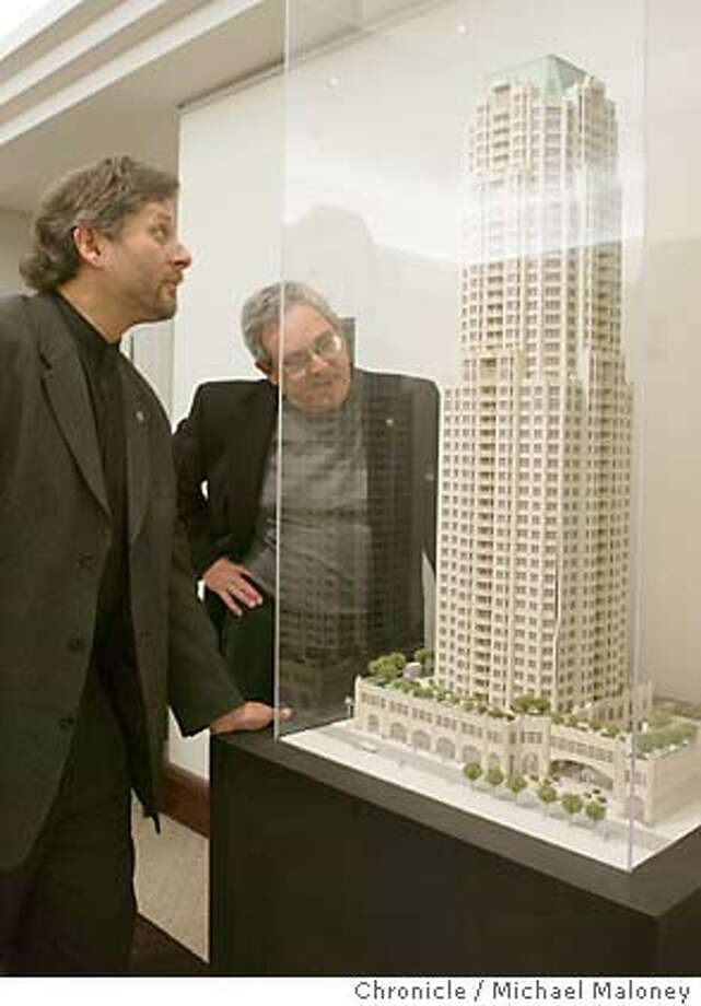 Jeff Heller (left) and Clark Manus of Heller - Manus Architects looking over a model of the 50 story Century high rise at Natoma and First Streets near the Transbay Terminal.  Event on 7/29/03 in San Francisco.  MICHAEL MALONEY / The Chronicle Photo: MICHAEL MALONEY