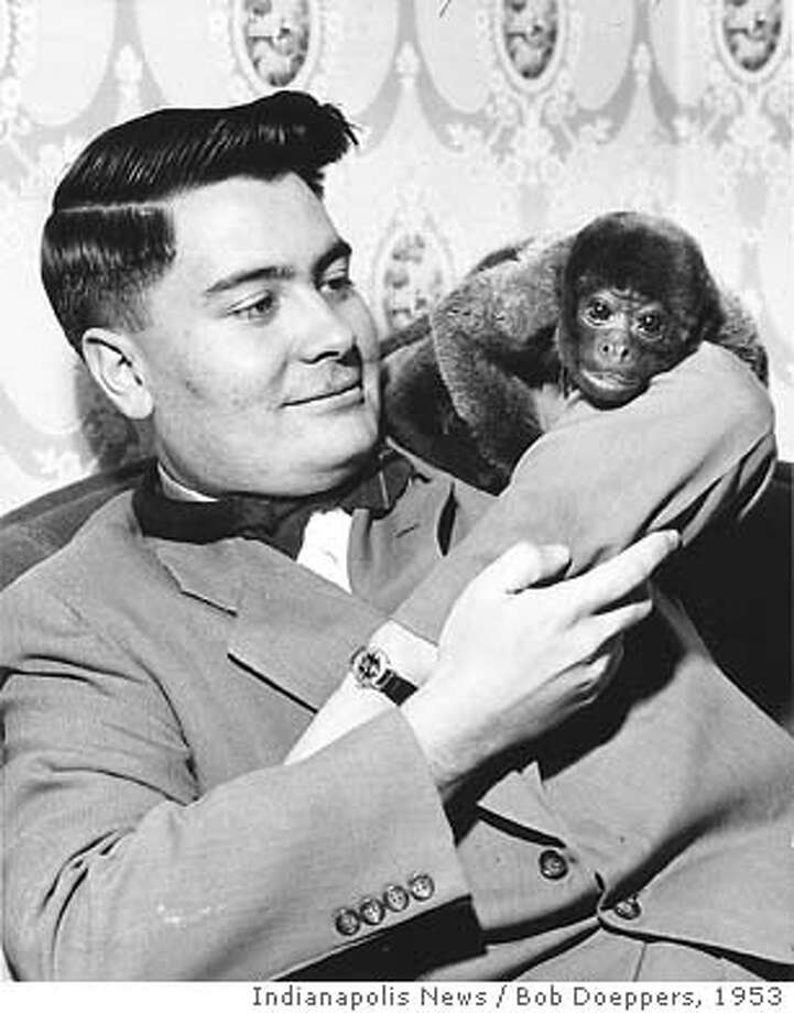 """for ; There was no hint of the dark, tragic legacy Jim Jones would leave behind in a remote South American colony when, in Dec. 1953, he playfully posed with """"Sugar"""", one of the monkeys an Indianapolis church sold to raise building funds. Long before the preacher gained international attention, Jones built a dedicated following of believers in Indianapolis. Starting out as a student pastor at Somerset Christian Assembly in June 1952, Jones soon after founded Peoples Temple Full Gospel Church in Indianapolis. Eventually, he moved it to Brazil, then returned to Indianapolis before leading 140 church members to Redwood Valley, Calif. He established congregations in San Francisco and Los Angeles, as well as a dozen smaller cities. He and his followers fled toJonestown in 1977. A 1972 Indianapolis Star investigation of Jones ministry uncovered some of his unorthodox practices, but no one could predict the bizarre ending in Jonestown, on Nov. 18, 1978, when Jones and 900 of his followers committed mass suicide by drinking cyanide-laced Kool-Aid (some against their will, facing down rifle barrels of armed guards). Photo by Indianapolis News photographer Bob Doeppers. Bob Doeppers, Courtesy Indianapolis News / Indianapolis News Photo: Bob Doeppers"""