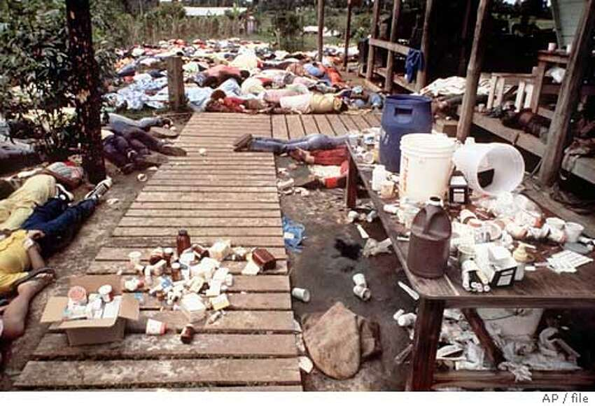 FILE--Bodies are strewn around the Jonestown Commune in Jonestown, Guyana where more than 900 members of the People's Temple committed suicide in Nov. 1978. The Rev. Jim Jones urged his disciples to drink cyanide-laced grape punch. Jones, who was among those who died, led the Peoples Temple, which ran a free clinic and a drug rehabilitation program.(AP Photo/file) 1978 file photo
