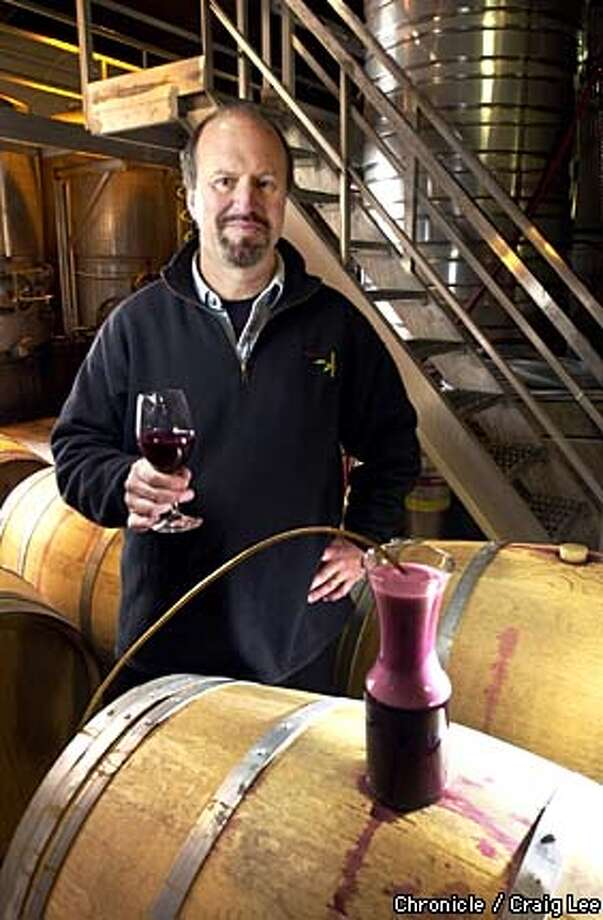 Michael Havens of Havens Wine Cellars in Napa is a pioneer in micro-oxygenation, designed to soften wine's tannins. Photo of Michael Havens with a demonstration of wine being micro-oxygenated with the effects of the bubble like foam on top of the wine.  Photo by Craig Lee/San Francisco Chronicle Photo: CRAIG LEE