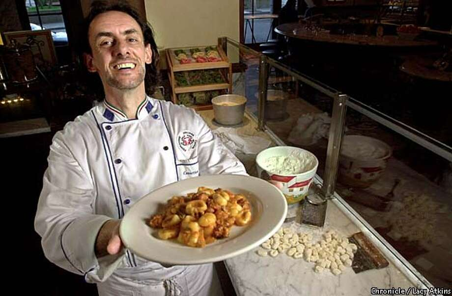 Work of Art: Maurizio Mazzon, executive chef of Il Fornaio, proudly displays gnocchi. Chronicle photo by Lacy Atkins