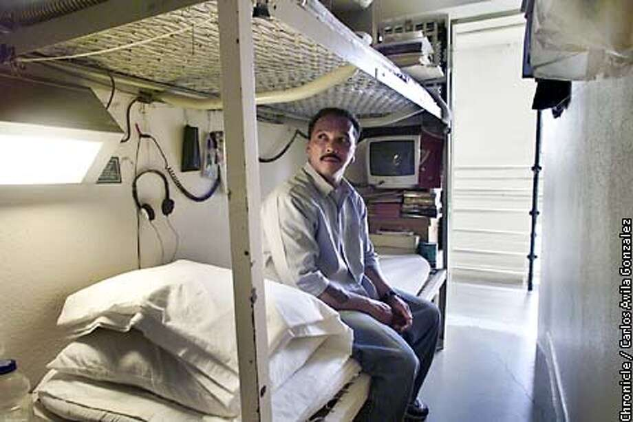 Julius Domantay looks out the door of his 6-foot by 9-foot prison cell, where he has lived since coming to San Quentin in 1993. Julius Domantay, an inmate at San Quentin, has been in prison since 1977, at the age of 17, for the murder of Salem 'Sam' Totah. Recently, after years of demonstrating good behavior and having changed his life through Christianity, the California State Board of Prison Terms granted him a rare parole. But true to his campaign promises, Gov. Gray Davis turned down the parole.  (PHOTO BY CARLOS AVILA GONZALEZ/THE SAN FRANCISCO CHRONICLE) Photo: CARLOS AVILA GONZALEZ