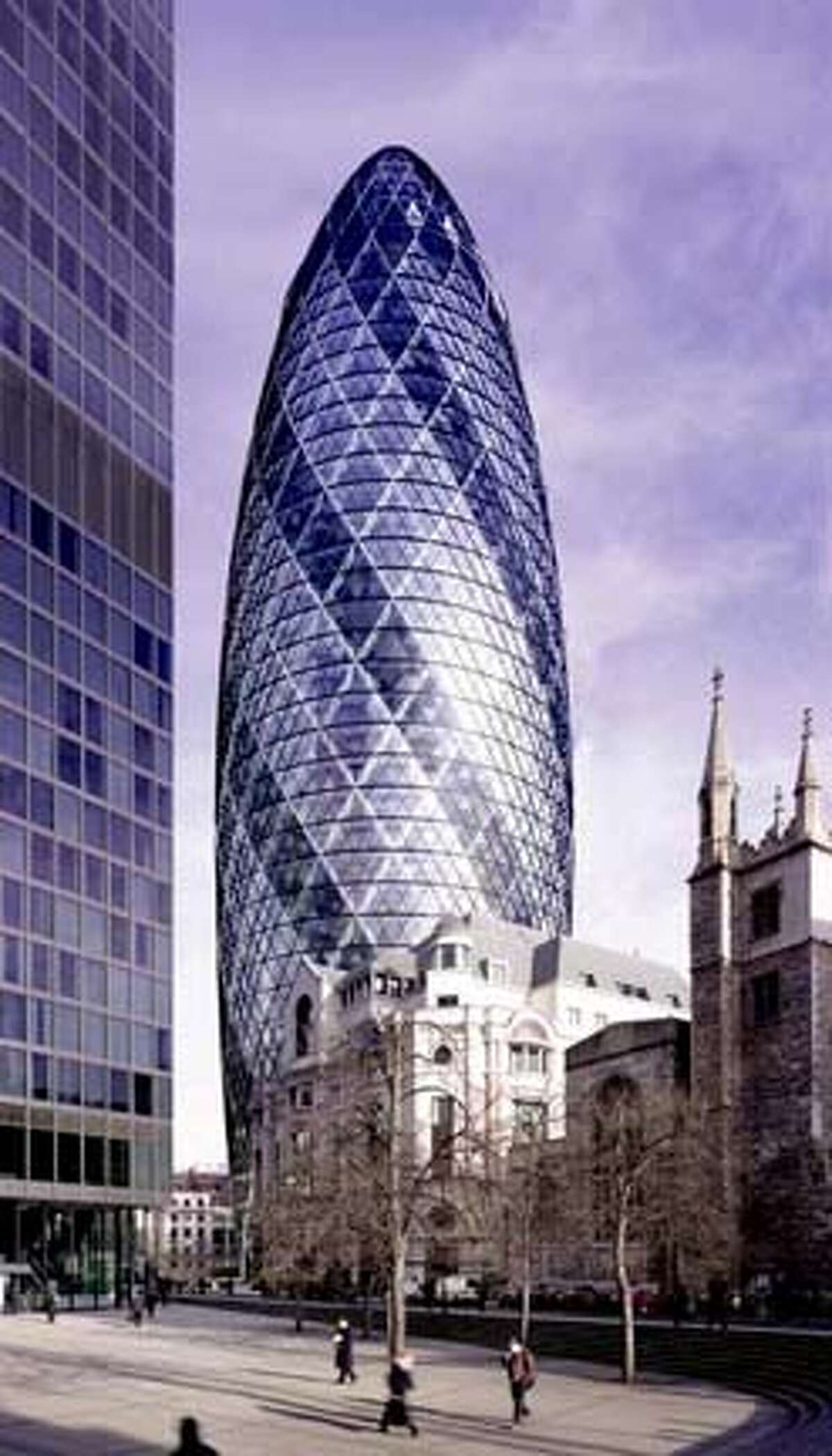 30 St Mary Axe. London. This site was formerly occupied by the Baltic Exchange, an historic building which was heavily damaged by an IRA bomb several years ago. Before 30 St Mary Axe was proposed, the London Millennium Tower was proposed and rejected for the same site. The building's shape has earned it numerous nicknames in the British press, including 'erotic gherkin' and 'towering innuendo'. The floor plan is rotated for each successive floor, creating a series of spiraling atria that stretch the full height of the building. HANDOUT.
