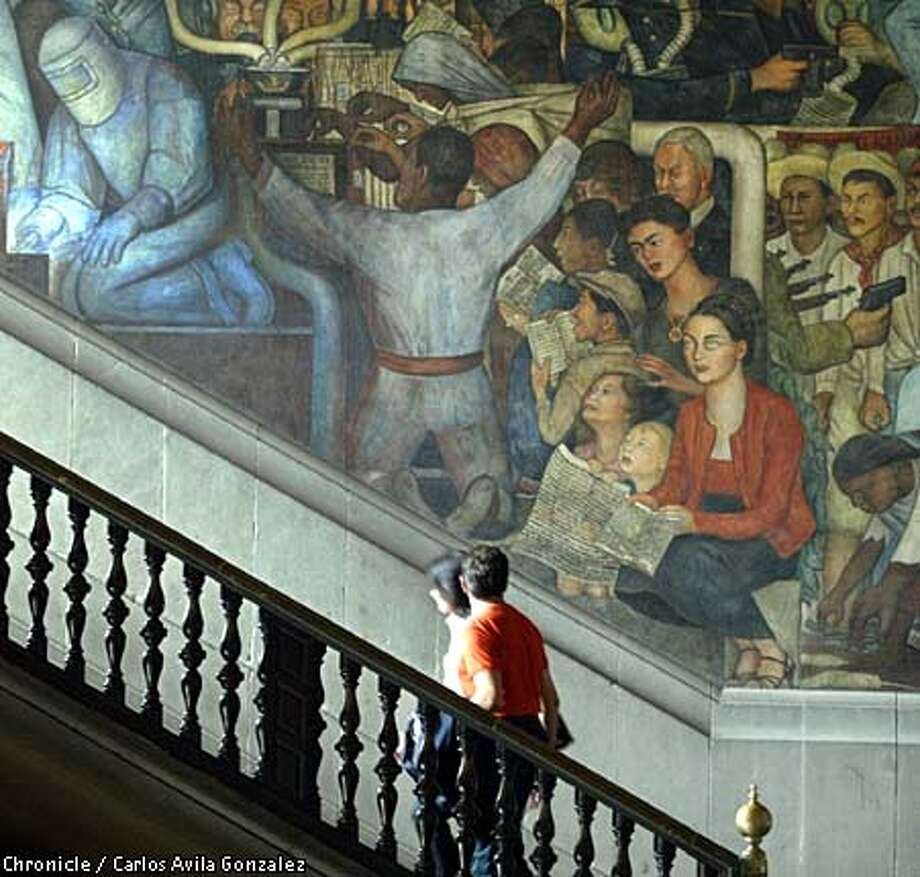 Struggling artists: Frida Kahlo is one among many in a Diego Rivera mural at the Palacio Nacional that promotes his socialist vision for Mexico. Chronicle photo by Carlos Avila Gonzalez